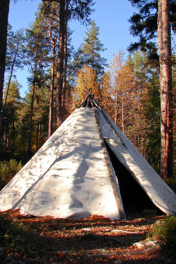Classic native Indian tee-pee. In forest stock image