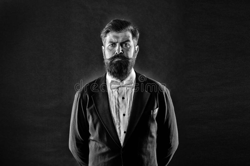 Classic never out of trend. Menswear classic outfit. Bearded man with bow tie. Well dressed and scrupulously neat stock image