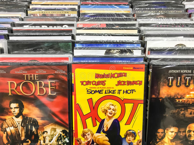 Classic And New Hollywood Production Movies On Dvd For Sale In Entertainment Center. BUCHAREST, ROMANIA - SEPTEMBER 20, 2016: Classic And New Hollywood stock photos
