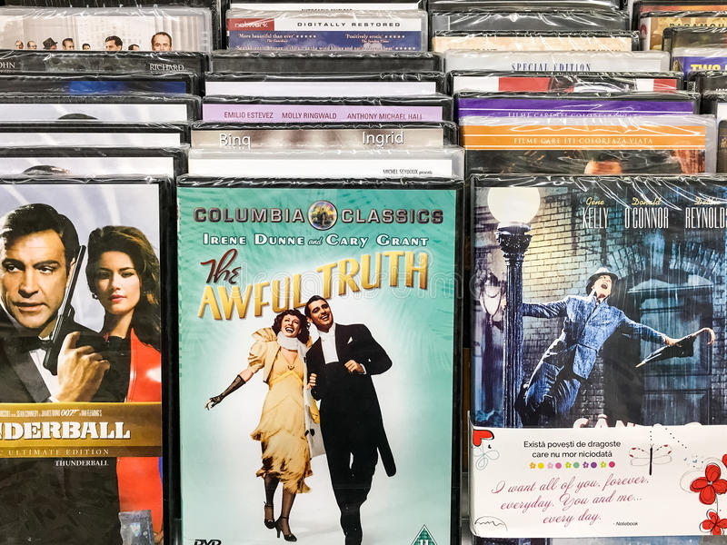 Classic And New Hollywood Production Movies On Dvd For Sale In Entertainment Center. BUCHAREST, ROMANIA - SEPTEMBER 20, 2016: Classic And New Hollywood royalty free stock image