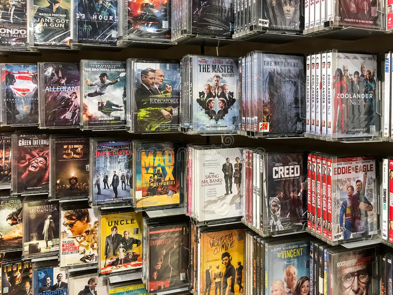 Classic And New Hollywood Production Movies On Dvd For Sale In Entertainment Center. BUCHAREST, ROMANIA - SEPTEMBER 20, 2016: Classic And New Hollywood royalty free stock photos