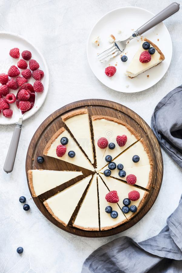 Classic New York cheesecake with fresh berries, top view stock photo