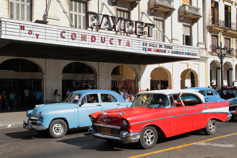 Classic old American cars and cinema hall royalty free stock images