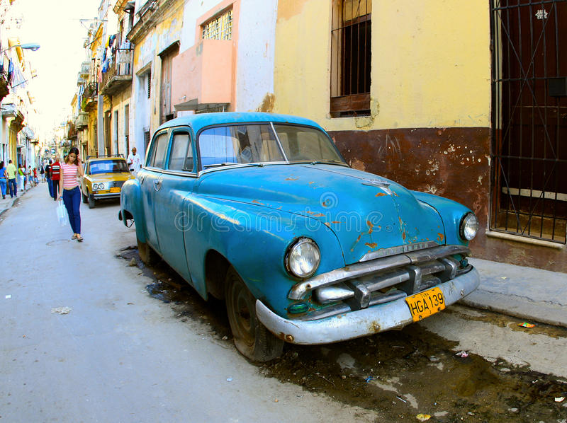 A classic old car is blue color stock photos