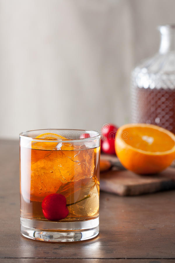 Free Classic Old-fashioned Cocktail On A Wooden Table Royalty Free Stock Photo - 33341135