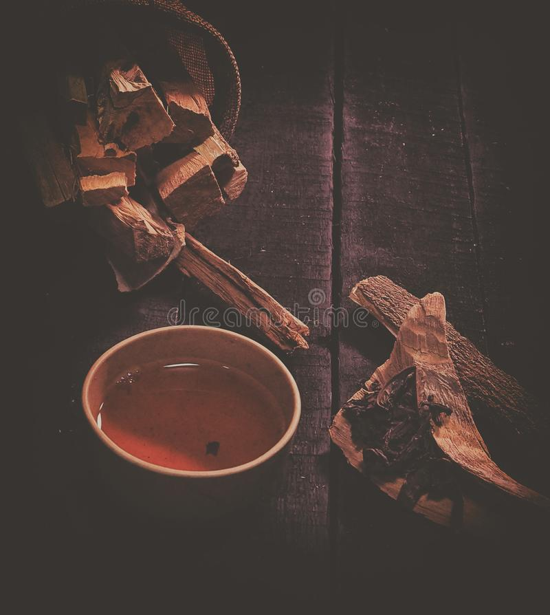 The classic old film design background of clay tea cup and herb stick royalty free stock image