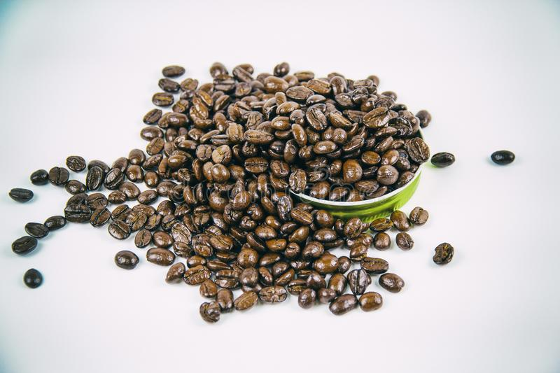 The classic old film design background of the roasted coffee beans put on white background stock photos
