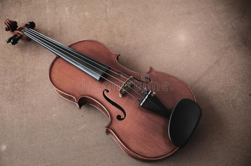 The classic old film design background of violin put on wooden board stock image