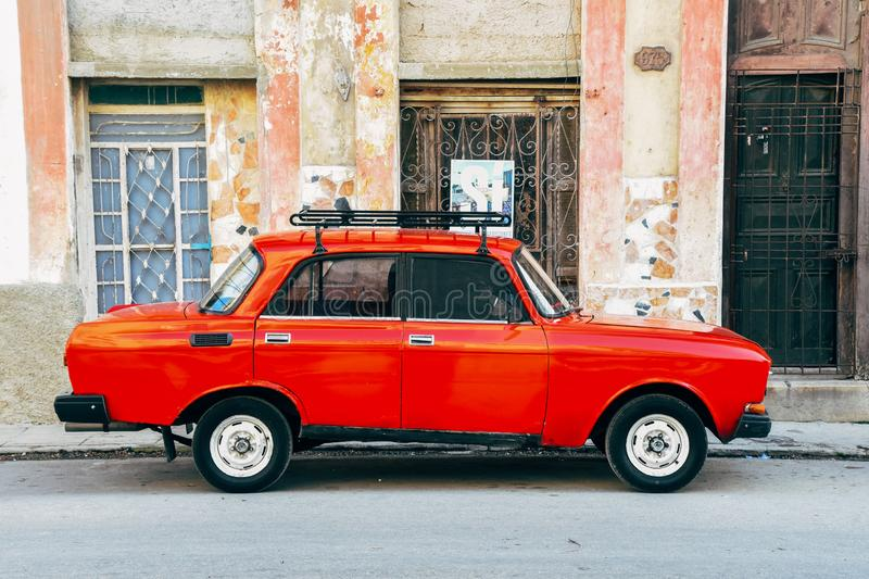 A classic old red Lada parked on the side of the street in Havana, Cuba. A classic red Lada parked on the side of the street in Havana, Cuba royalty free stock images