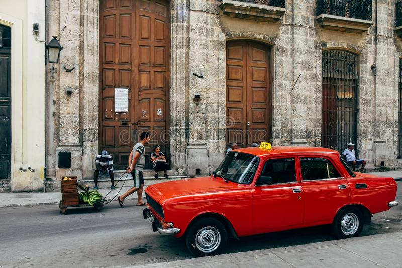 A classic old Lada parked in Havana, Cuba. A classic old red Lada taxi parked in Havana, Cuba stock image