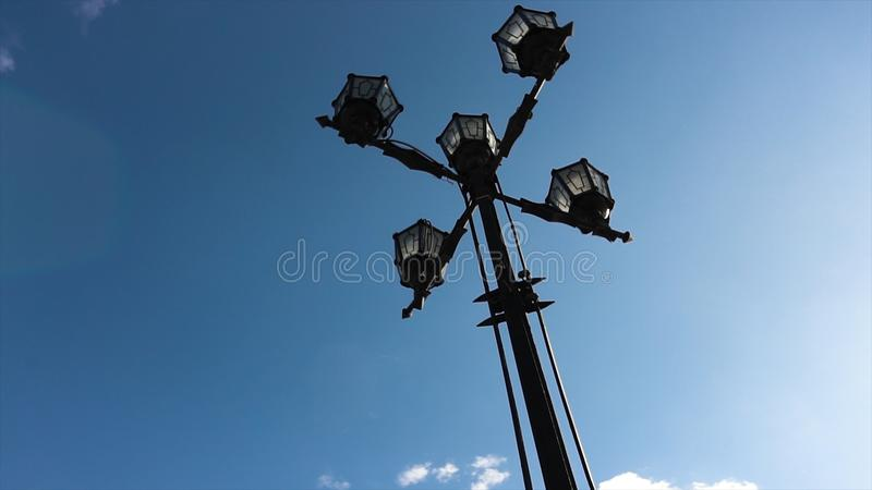 Classic Older Lamp and Blue Sky. Old Fashioned Street Light against a Blue Sky. Vintage style street lights by the day royalty free stock photos