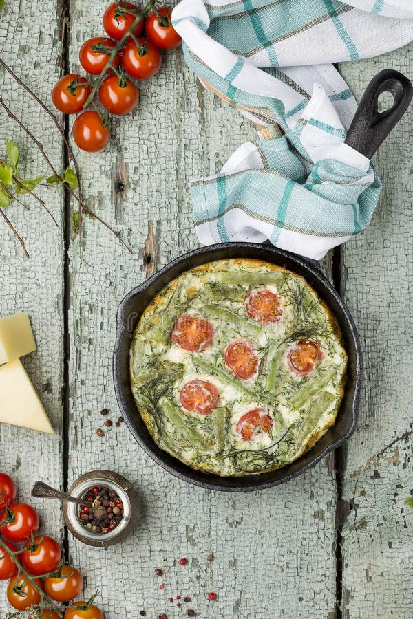 Classic omelet with cherry tomatoes, cheese and herbs stock photo