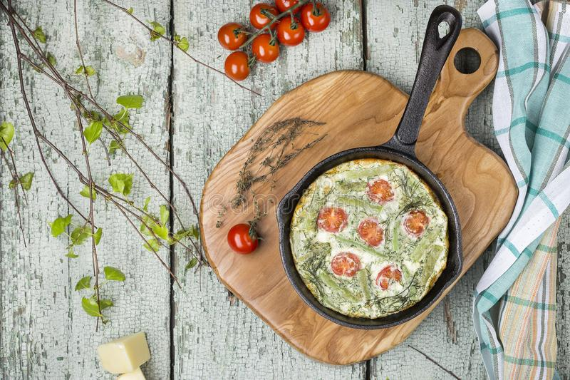 Classic omelet with cherry tomatoes, cheese and herbs stock photos