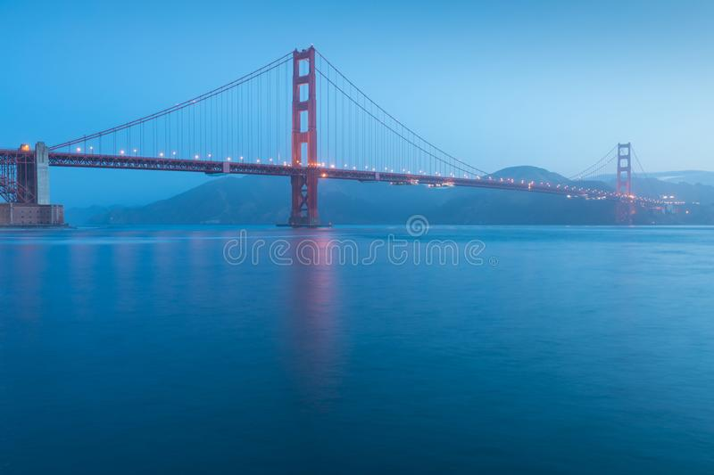 Classic panoramic view of famous Golden Gate Bridge seen from San Francisco harbour in beautiful evening light on a dusk. royalty free stock images
