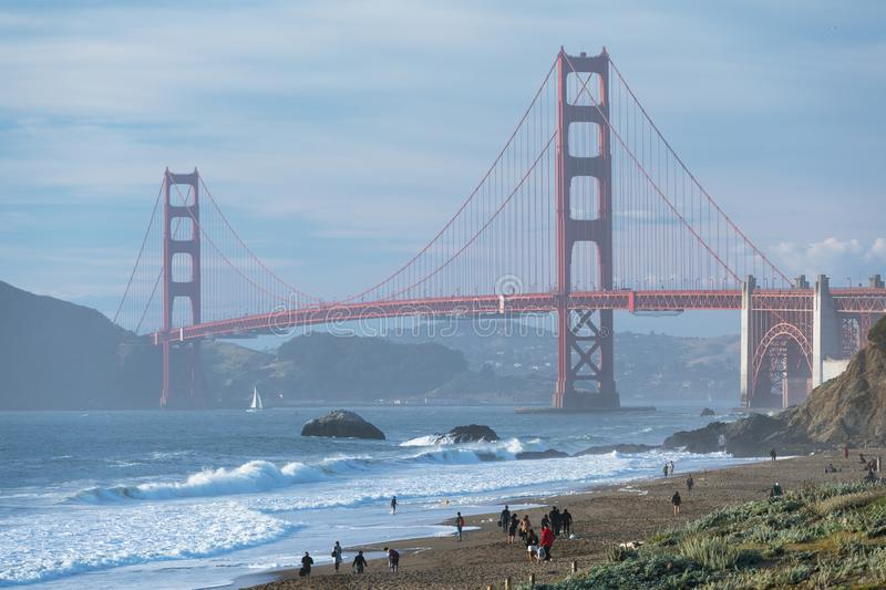 Classic panoramic view of famous Golden Gate Bridge seen from scenic Baker Beach in beautiful golden evening light on sunset. stock images