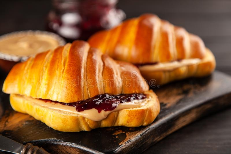 Peanut butter and jelly sandwich. Classic peanut butter and jelly sandwich royalty free stock images