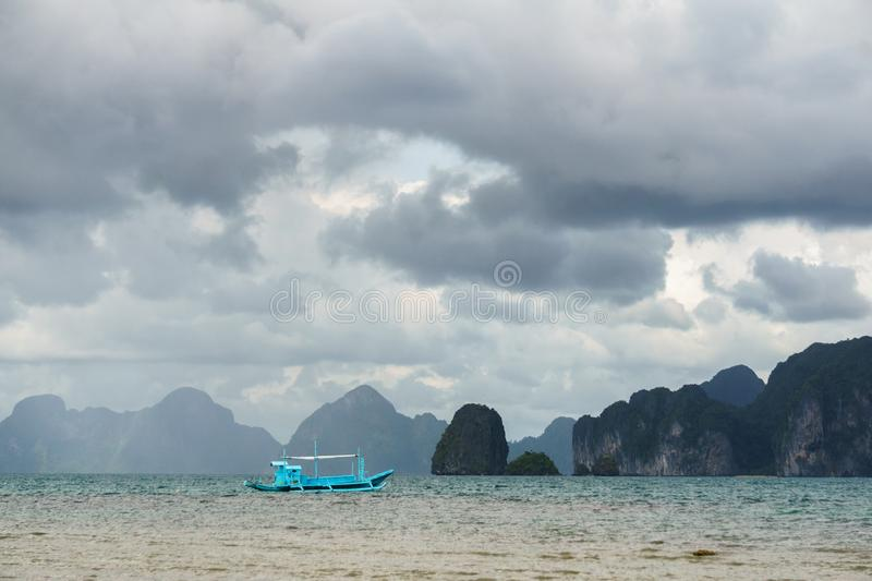 Classic Philippine fishing boat on the background of the sea landscape royalty free stock images