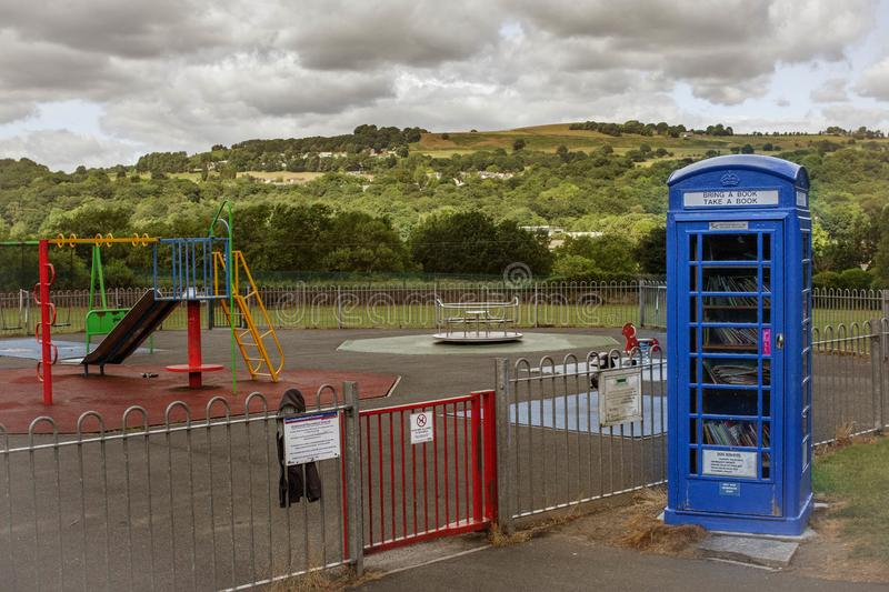 Classic phone box turned into a Little Free Library royalty free stock images