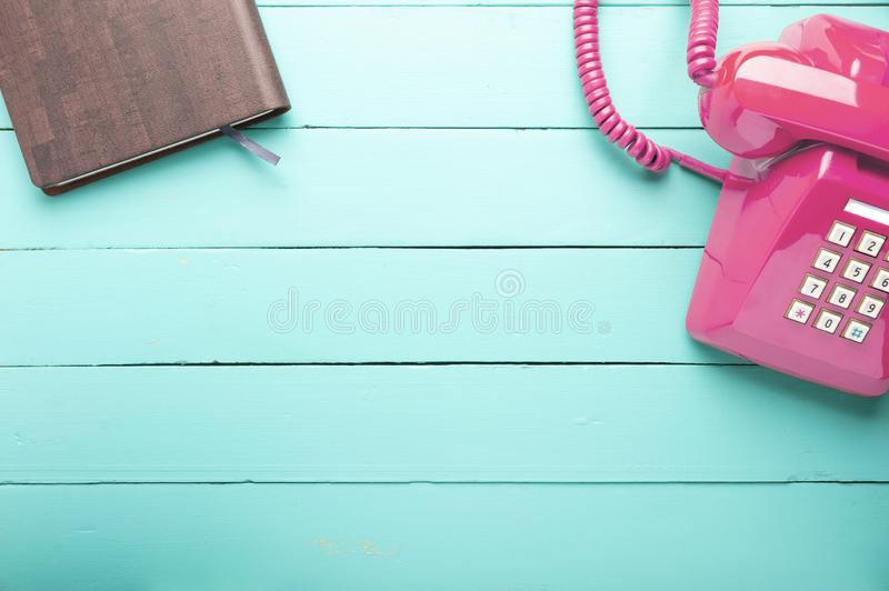 Classic pink telephone royalty free stock image