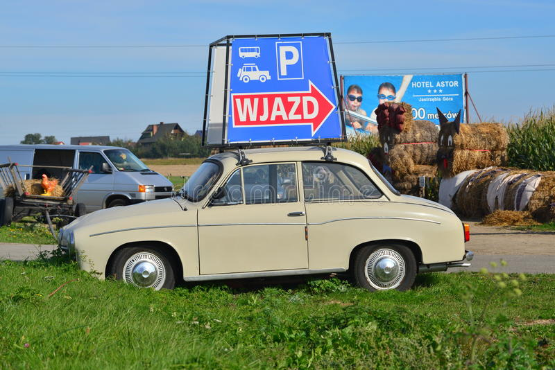 Classic Polish Car. Old classic Polish car Syrena 105 with two stroke three cylinder motor as an advertisement on the road to Wladyslawowo, northern Poland royalty free stock photos