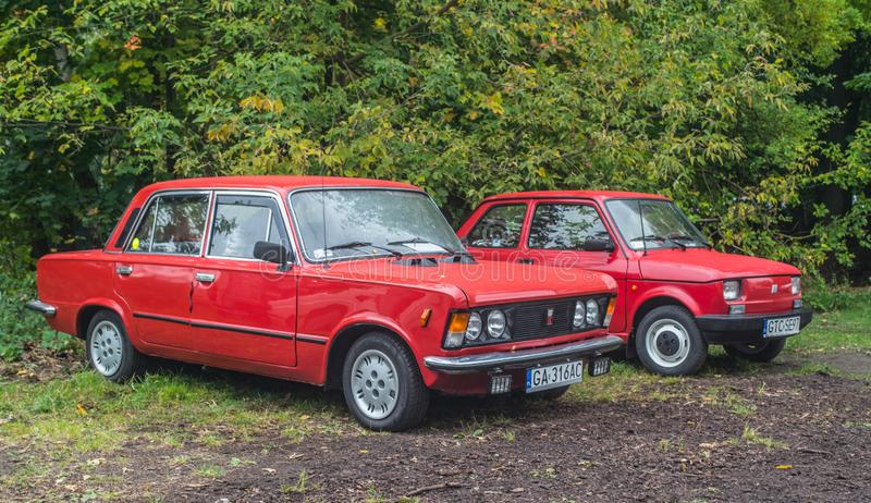 Classic Polish cars Polski Fiat 125p and 126p in red. Classic Polish cars built on Italian licence Polski Fiat 125p and Polski Fiat 126p in red color. Old cars royalty free stock photography