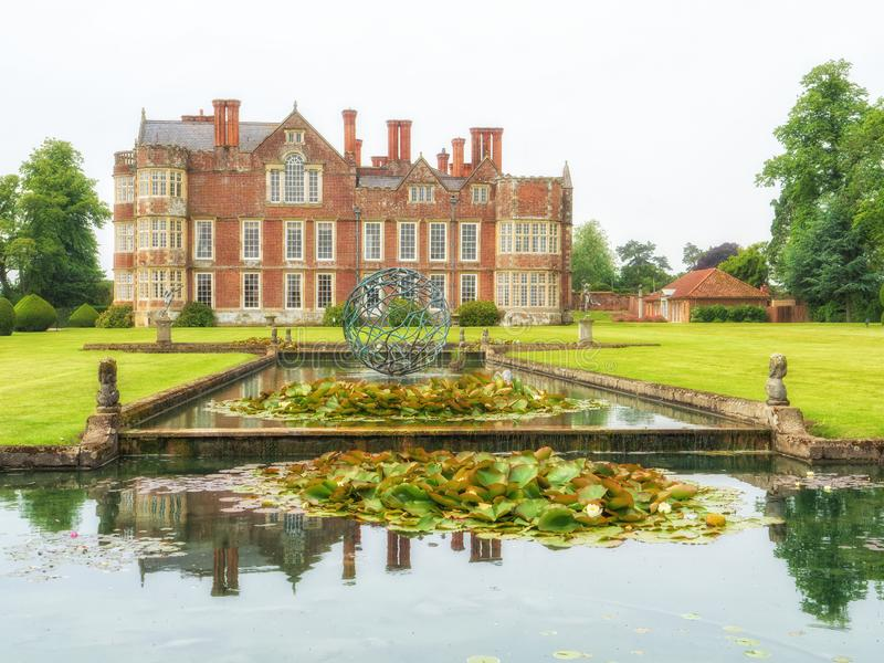 Classic pond at Burton Agnes Hall, Yorkshire, England. The classic pond with contemporary water sculpture   and side side elevation of the magnificent stock photo