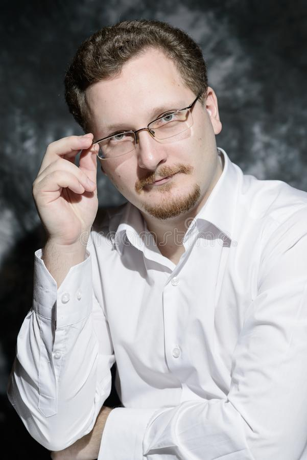 Classic portrait of man in white shirt and glasses stock image