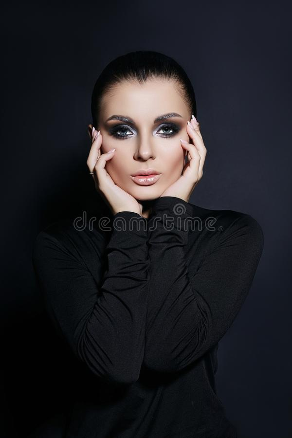 Classic portrait of woman with perfect evening makeup, successful woman on black background. Perfect skin without wrinkles, royalty free stock photo