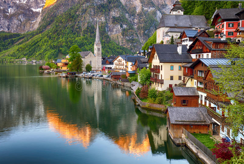 Classic postcard view of famous Hallstatt lakeside town reflecting in Hallstattersee lake in the Austrian Alps in scenic morning royalty free stock photography