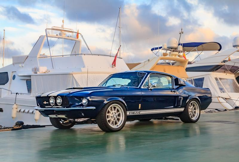 Classic rare American muscle car, vintage blue Ford Mustang Shelby Cobra GT-500 Fastback on a pier in Palma de Mallorca in royalty free stock images