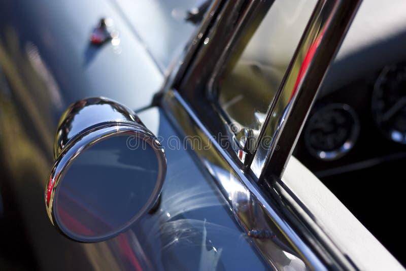 Classic rear mirror on blue car