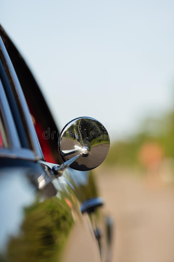 Classic rear-view mirror stock photography