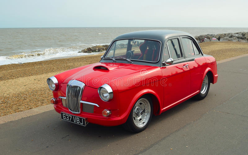 Classic Red & Black Riley 1.5 motor car parked on seafront promenade. royalty free stock images