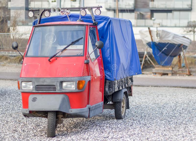 Tuk-Tuk parked at the dock. Classic red and blue three wheels Tuk-Tuk parked at the dock royalty free stock images