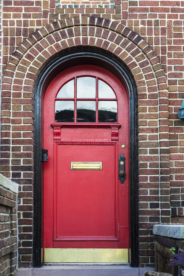 Red door of a house in Brooklyn in New York City, USA. Classic red door of an old typical house in the Brooklyn neighborhood in Manhattan, New York City, USA stock images