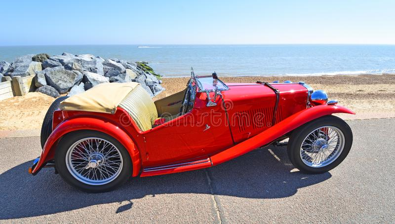 Classic Red MG Sports Car parked on Seafront  Promenade. FELIXSTOWE, SUFFOLK, ENGLAND - MAY 06, 2018:  Classic Red MG Sports Car parked on Seafront  Promenade stock photography