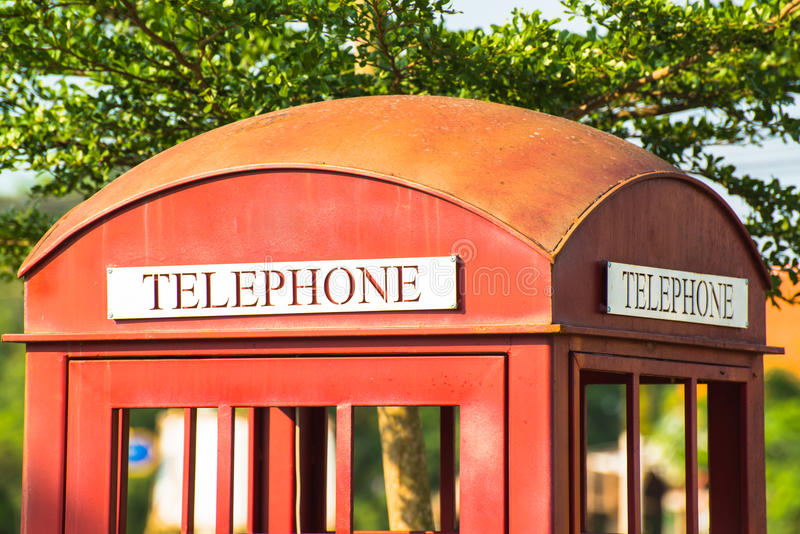Classic red telephone booth. As the decoration stock photo