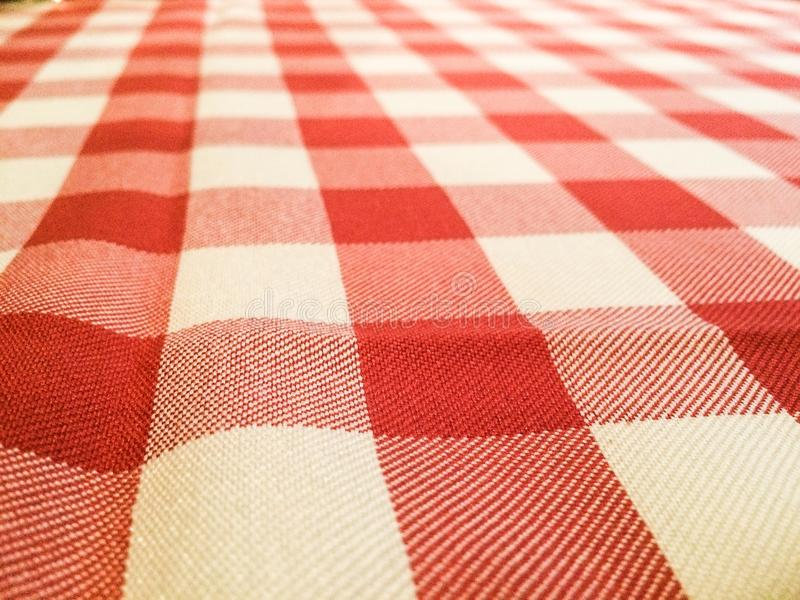 Classic Red and White Picnic Table Cloth. The classic stripped red and white picnic cloth in a fading out of perspective royalty free stock photos