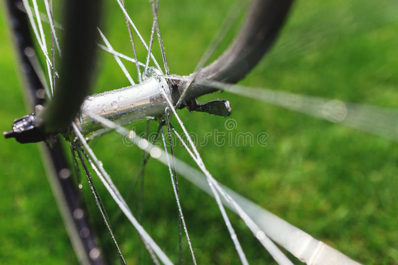 Classic road bicycle close-up photo in the summer green grass meadow field. Travel background. Classic road bicycle close-up photo in the summer green grass stock photography
