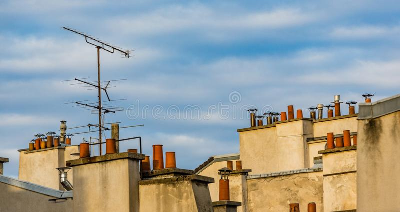 Classic rooftop view of chimneys in Paris, France stock photo