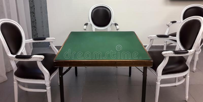 Classic room for Bridge playing game. Game over. Nobody is here royalty free stock images