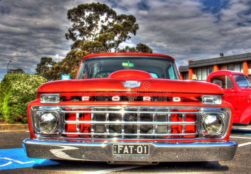 Classic 1960s American Ford pickup truck. Classic 1960s red American Ford pickup truck on display at car show in Melbourne, Australia royalty free stock photography