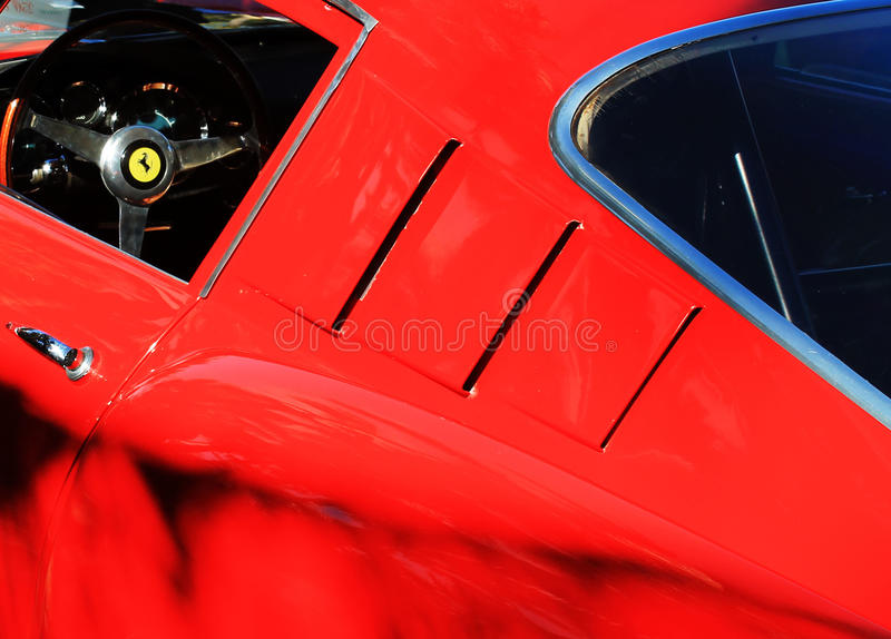 Classic 1950s Italian racecar. Side details. 1958 Ferrari 250 GT LWB TdF racer outdoors on a sunny day stock image