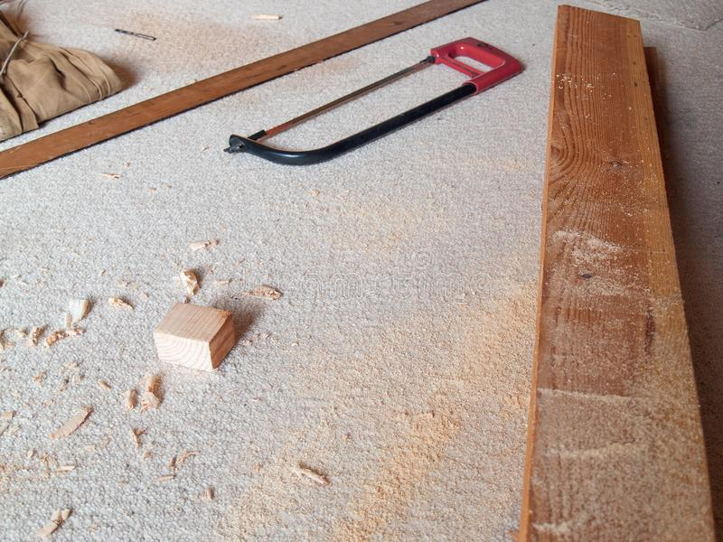 Classic saw and jack plane made chips on bright carpet royalty free stock photos