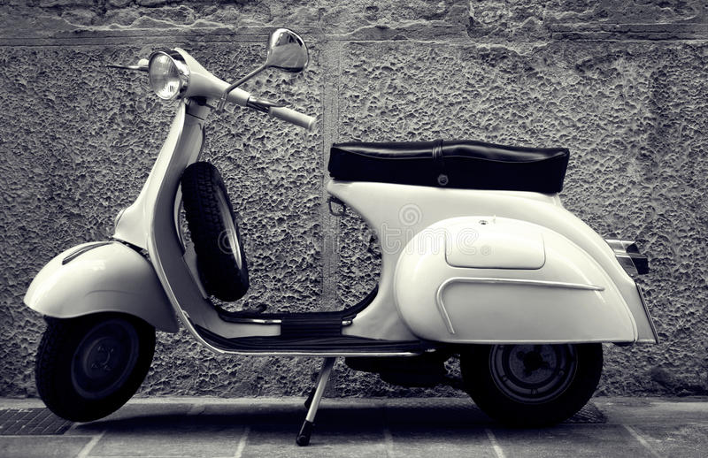 Classic scooter. Old Italian scooter parked in the street stock image