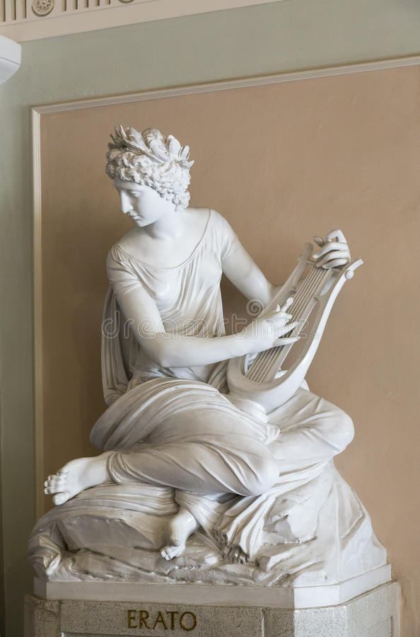 Classic sculpture of muse Erato. Classic sculpture showing muse Erato playing music stock images