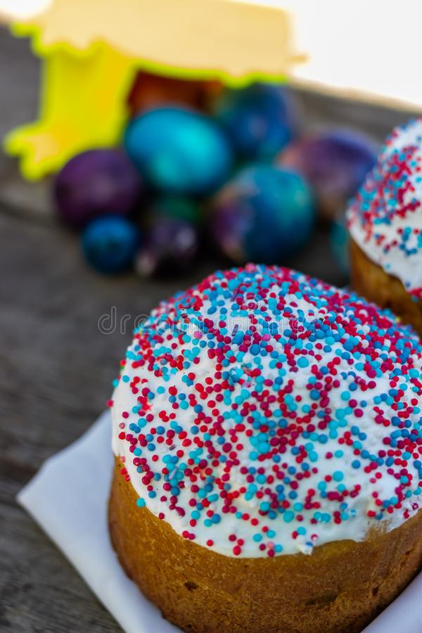 Classic Slavic Easter cakes with Easter eggs on a wooden table stock images
