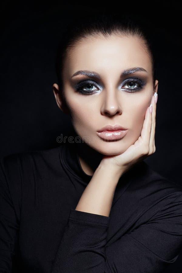 Classic Smokey makeup on woman face, beautiful big eyes. Fashion Perfect makeup, expressive eyes on girl face, smooth black stock photos