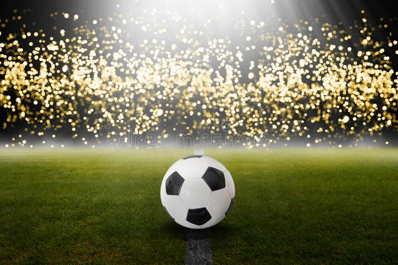 Classic soccer ball on the field with blurred lights. royalty free stock photos