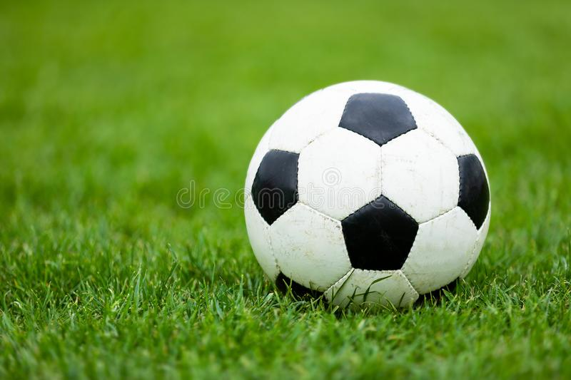 Classic Soccer Football Ball on Soccer Pitch. Green Grass Soccer Field royalty free stock image